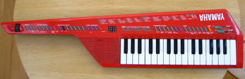 A Yamaha electronic keyboard with auto-accompaniment and auto-chord features