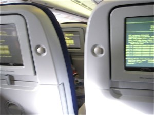 Onboard screens in a plane all showing a computer crash