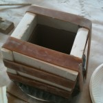 a square bowl drying in its plaster mold